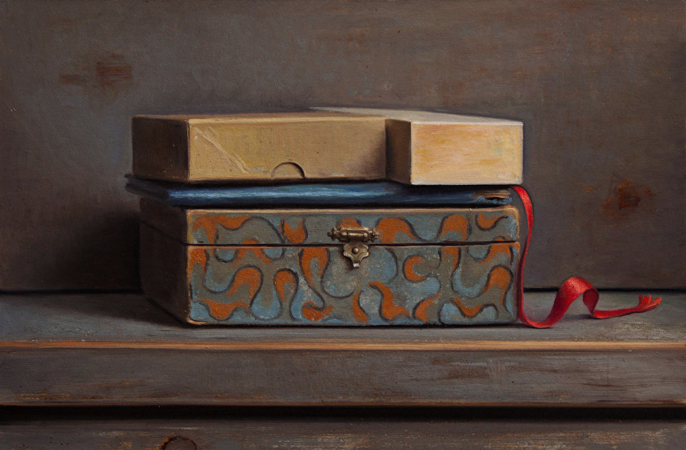 Still life with blue book and red ribbon
